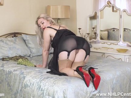 Busty blonde Elle frigs off in vintage corselette nylons and heels